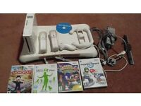 wii with balance board games and accessories
