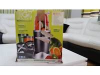 Nutribullet 12 piece set including cookbook and 1 pocket nutritionist