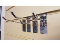 Large quantity of used slatwall hooks for sale