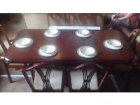 Rectangular Dark Wood Extending Dining Table with Six Chairs