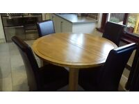 Extendable oak table and 4 leather chair set