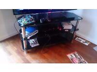 Black glass tv unit three shelves, great quality. Suit large tv
