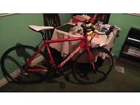 c boardman sport racing bike in red.