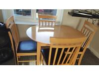 DINING TABLE AND 4 CHAIRS VERY GOOD CONDITION