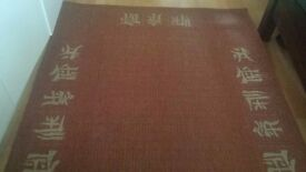 Wool/jute blend rug (Rust coloured) - 120x170cm - asian characters border