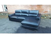 Lovely BRAND NEW black leather corner sofa .good size. never used .can deliver