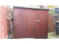 Non sectional wooden shed
