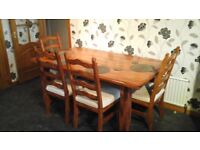 Solid oak Dining table and 4 chairs dark oak