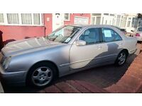 Mercedes E240, silver, elegance model. Very low mileage, regularly serviced.