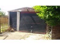 Used prefabricated concrete double garage with pebble dash exterior for sale