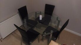 Extendable glass dining table + chairs