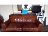 Brown leather sofa (double sofa bed)