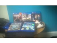 ps4 with 2x controllers and 5 top games
