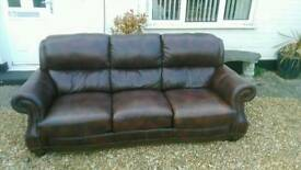 Reduced Price, Brown leather three seater sofa. WANTED GONE..