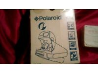 New boxed polaroid instant picture slides out straight away.No need for developing