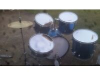 Collection of drums, cymbals and stands