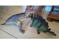 Two large toy dinosours