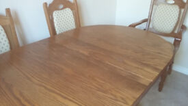 Solid oak extendable dining table and 6 chairs