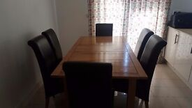 Harveys Keswick Dining Table and 6 Faux Leather Brown Chairs