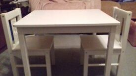 Childs size table and two chairs