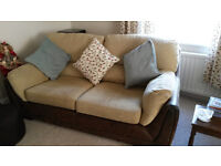 Lovely brown weathered look faux leather sofas with beige cushions. Matching footstool