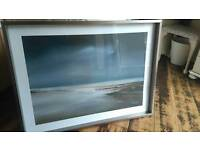 Beach print in silver frame.