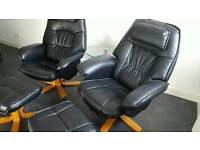 2 black leather reclining swivel chairs + footstools + table