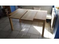 Extendable Ikea dining table and eight chairs
