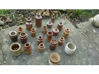 Collection of small ceramic pots, jars and jugs