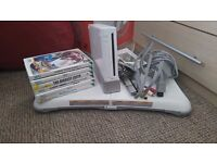 Wii + balence board + 6 games