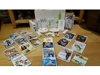 Wii console, wii fit board, controllers, nun-chucks and over 20 games