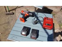 Snap on 1/2 inch gun w charger and 2 batterys