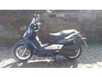 SYM Citcom 300i city com 300 i joymax predacessor city comm maxi scooter