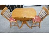 solid pine dropleaf table and 2 matching chairs. excellent condition. can deliver