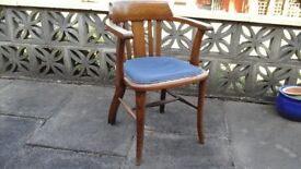 Wooden antique chair with blue leather seat