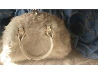 White fluffy handbag