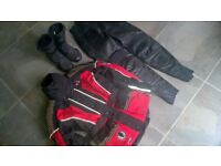 Like-new condition ladies motorbike jacket, leather trousers , boots and gloves.