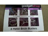 New - 6 metal brain busters