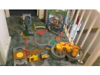 Thomas the tank engine playsets and track with trains.