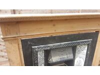 Cast iron victorian style tiled fireplace and solid wood surrounding