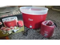 Tommee Tippee steriliser and bottle warmer , not used because we had the old ones