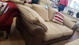 Chunky 2 seat sofa and large footstool in leather effect and a chenille fabric