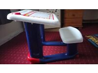 Light weighted Kids writing table with attached seat. As shown in the pictures.
