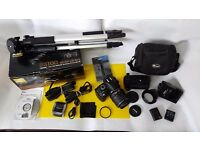 Nikon D D3100 14.2MP DSLR w/ AF-S DX VR 18-55mm Lens Starter Kit!