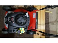 Petol mower as new used once cost 200 selling for half the price
