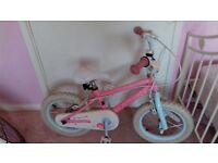 Young girls pink bike