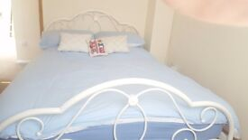 White metal frame. Double bed