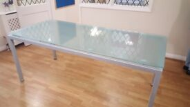 4 solid glass top dining tables