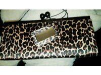 Next leopard print clutch