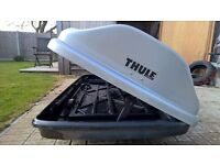 Thule roof box 2.3m long with adjustable roof bars and 4 keys. Opens both sides